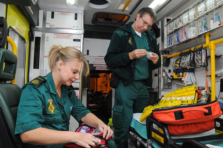 Ambulance crew prepare for night out on shift in the back of their ambulance